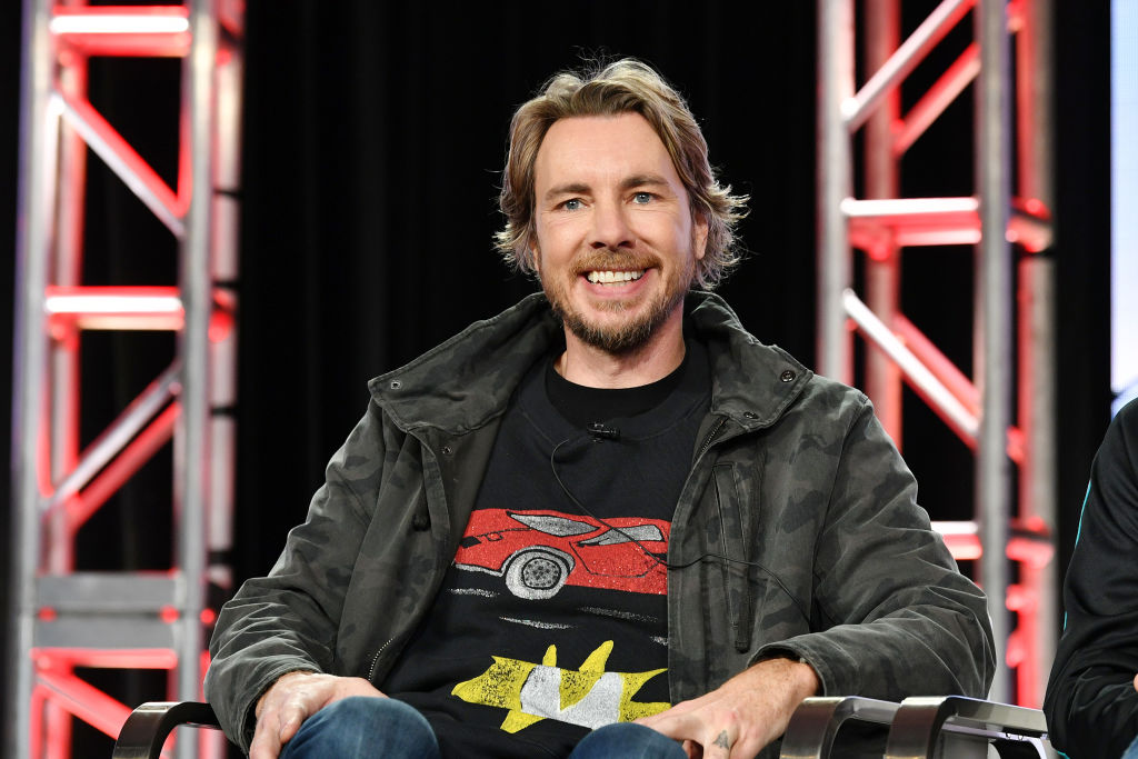 Dax Shepard smiling in a chair