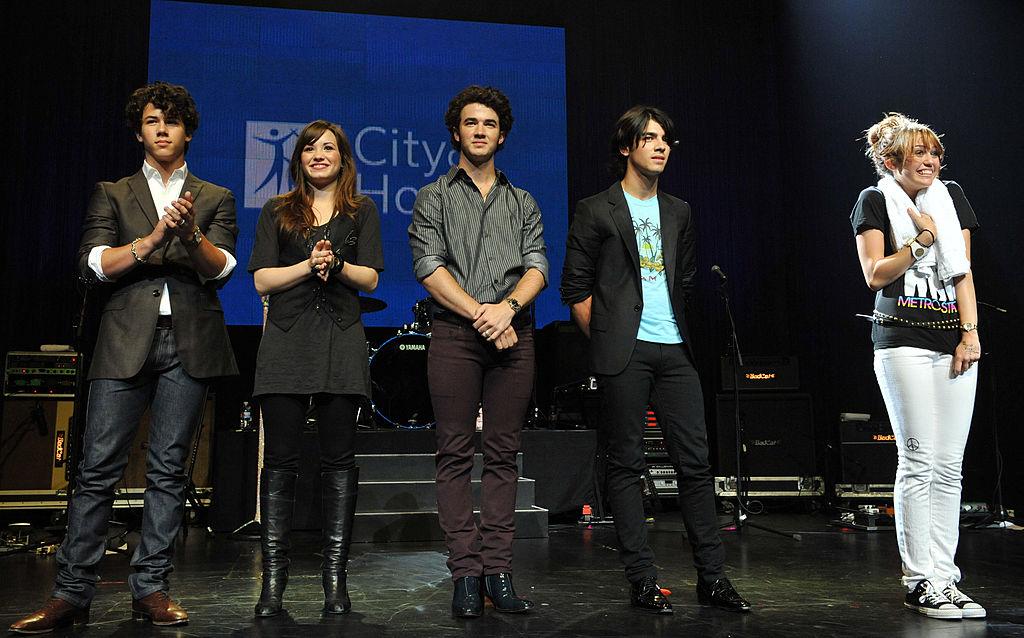Nick Jonas, Demi Lovato, Kevin Jonas, Joe Jonas and Miley Cyrus attend the City of Hope Benefit Concert