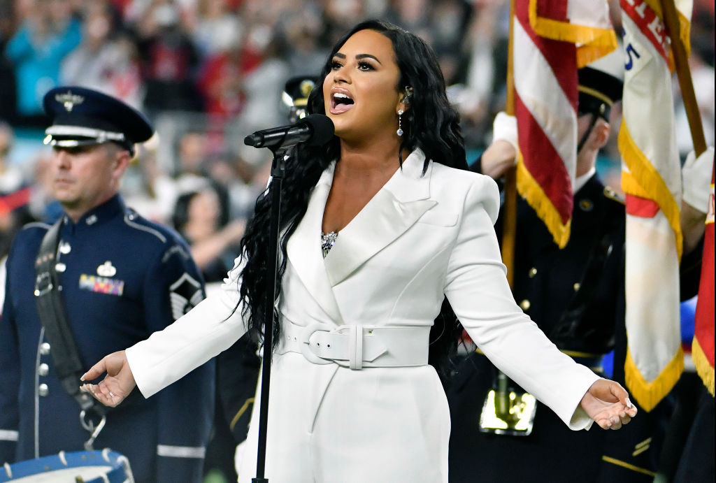Demi Lovato performs the National Anthem prior to the start of Super Bowl LIV