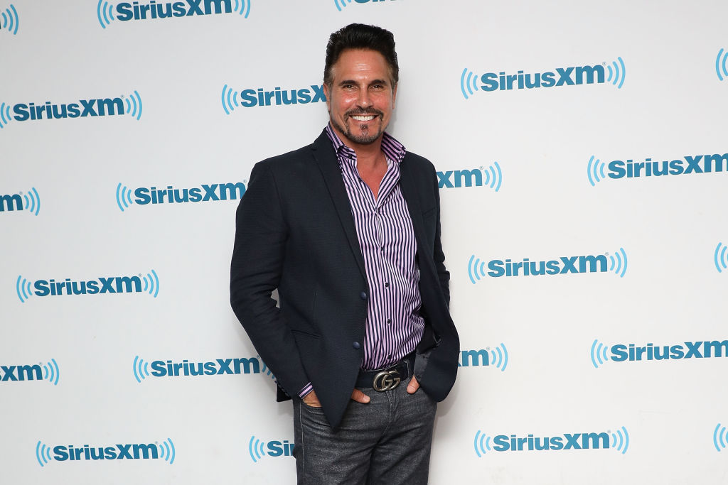 Don Diamont smiling in front of a repeating background