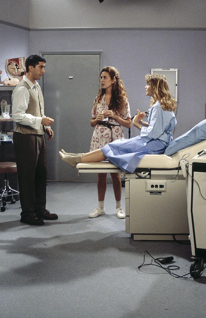 David Schwimmer as Ross Geller, Jessica Hecht as Susan Bunch and Anita Barone as Carol Willick