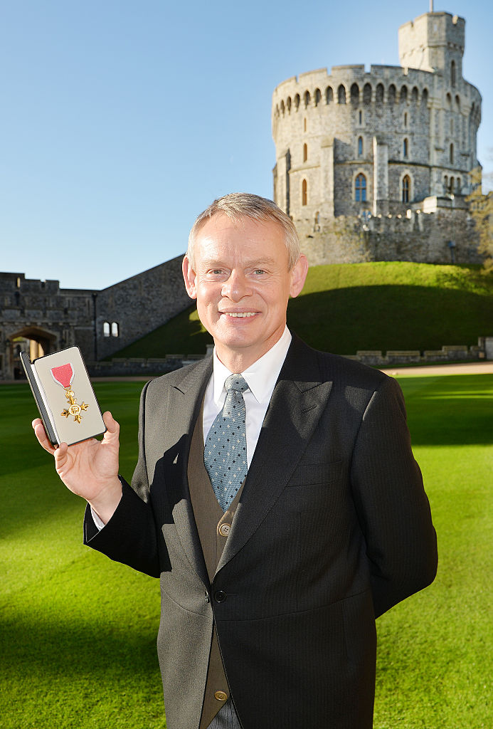 Martin Clunes after receiving an Officer of the Order of the British Empire (OBE) from Queen Elizabeth II, 2015