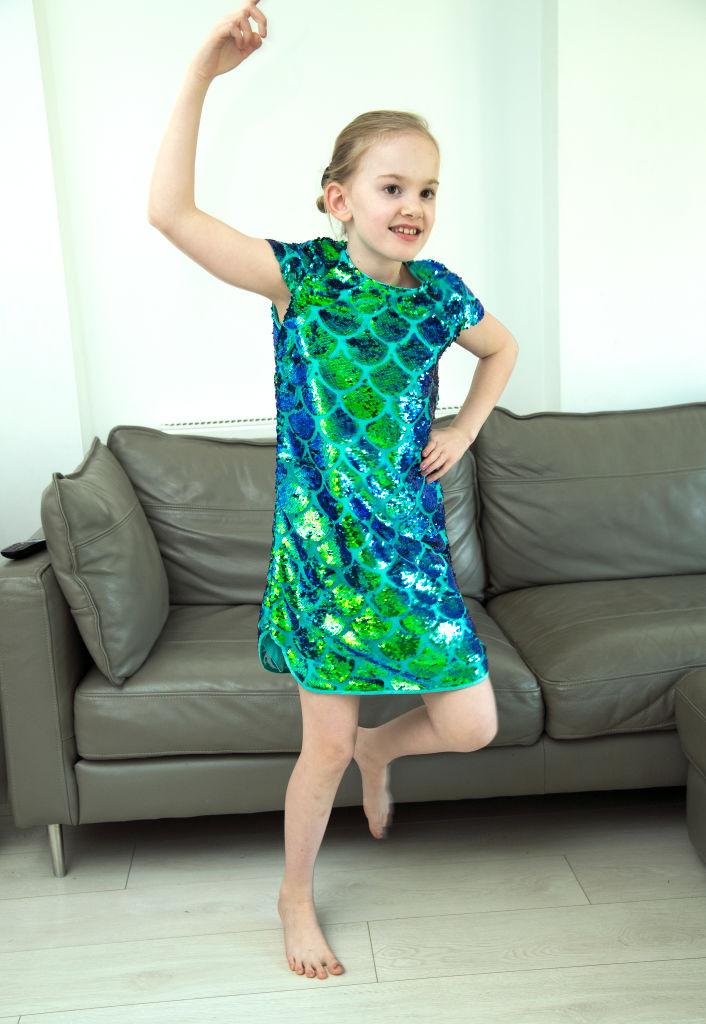 Girl dancing in living room