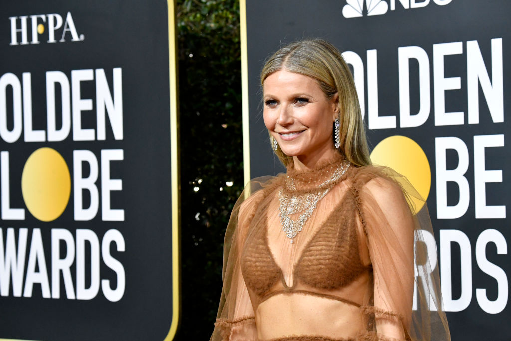 Gwyneth Paltrow smiling looking off to the side