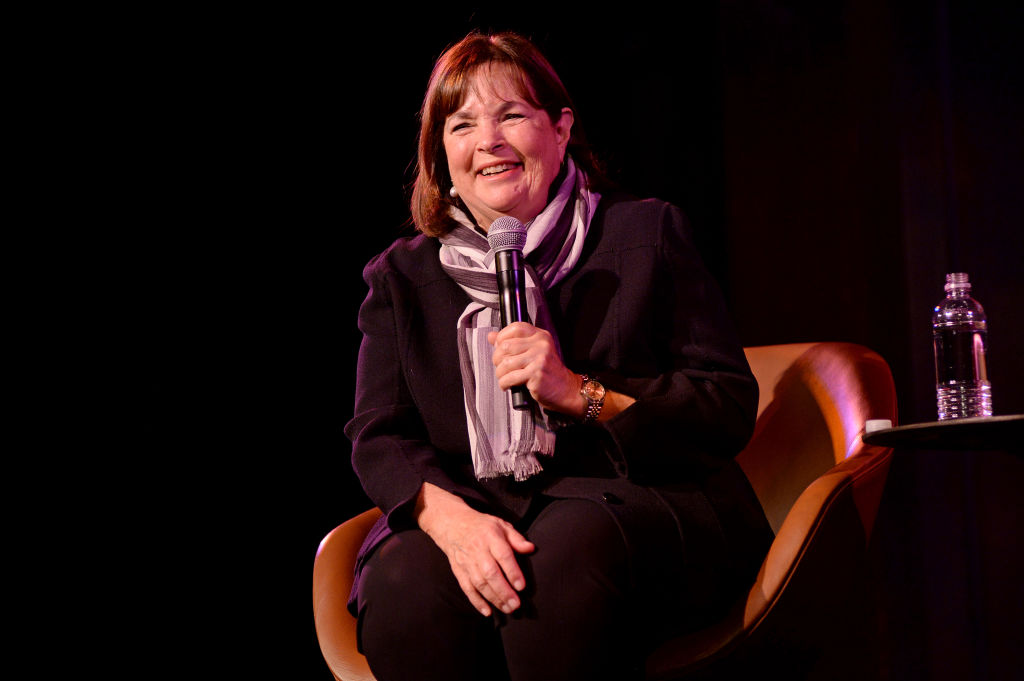 Ina Garten holding a microphone sitting in a chair