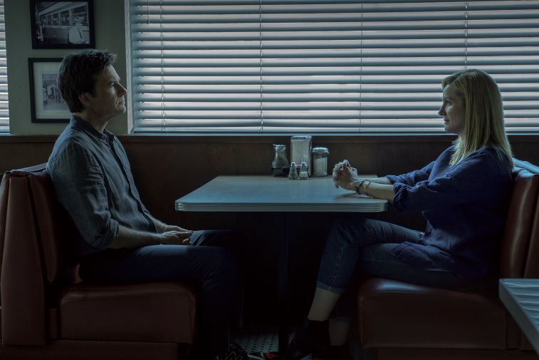 Jason Bateman and Laura Linney staring at each other in a diner