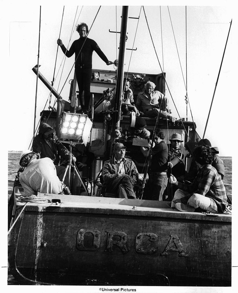 Roy Scheider on top deck as crew set up to film a scene from the film 'Jaws' 1975