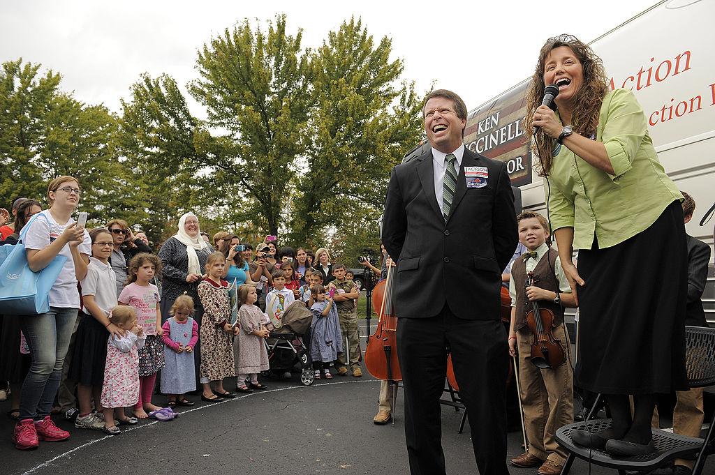 Jim Bob Duggar, center, and his wife, Michelle Duggar, make a stop on their 'Values Bus Tour'