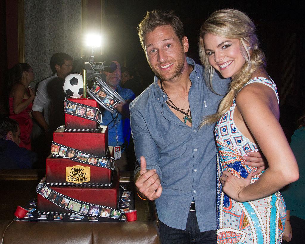 Juan Pablo Galavis and Nikki Ferrell pose with his birthday cake at Juan Pablo Galavis' birthday bash party
