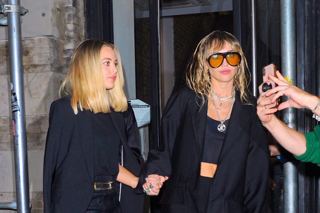 Kaitlynn Carter and Miley Cyrus are seen on September 10, 2019 in New York City.