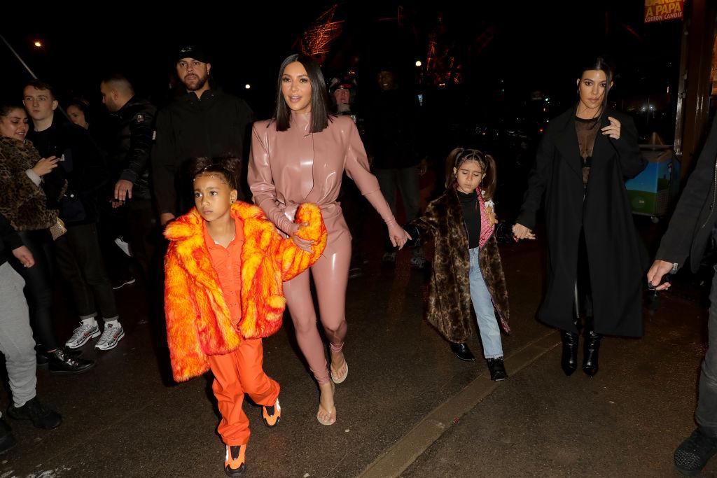 Kim Kardashian, North West, Penelope Disick and Kourtney Kardashian outside in a crowd