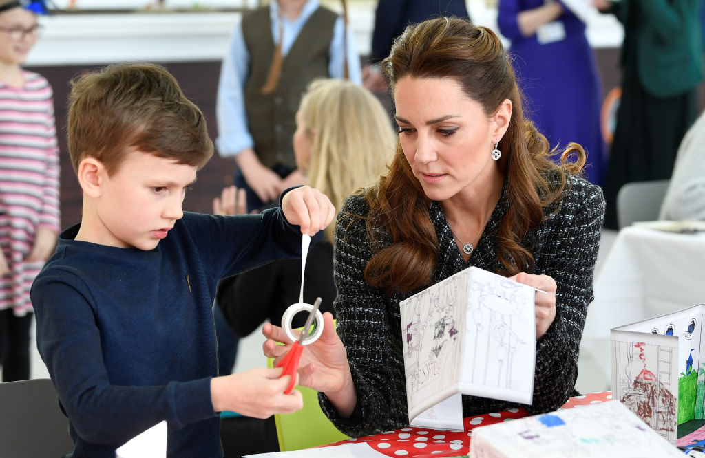 Kate Middleton helps a child during a workshop run by the National Portrait Gallery's Hospital Programme at Evelina Children's Hospital