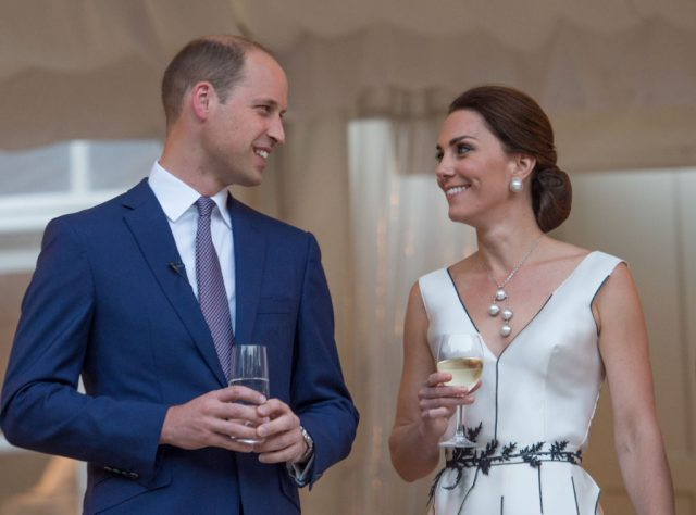 Kate Middleton and Prince William holding drinks