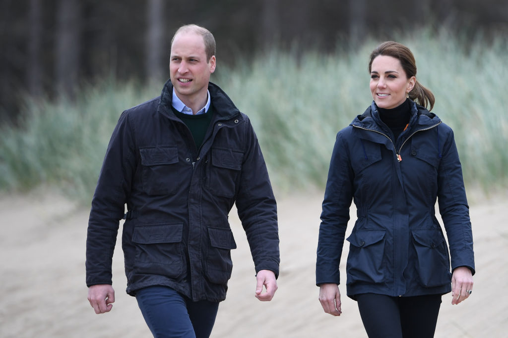 Kate Middleton and Prince William walk on a beach in 2019