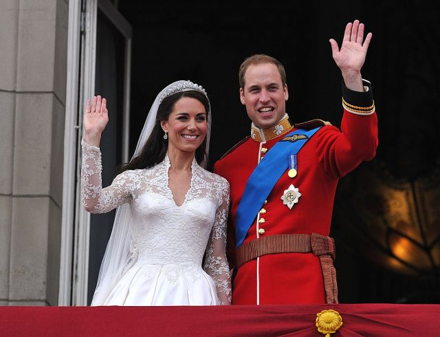 Kate Middleton and Prince William wave to crowds at their royal wedding