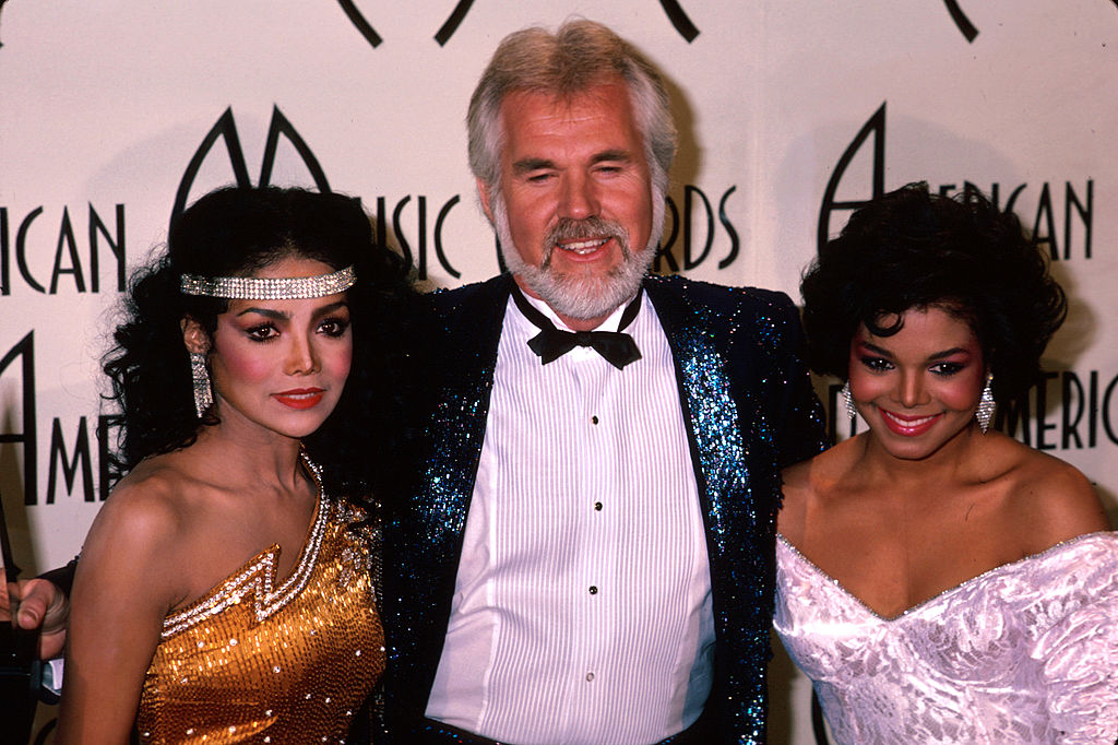 Kenny Rogers at the American Music Awards with Latoya Jackson and Janet Jackson |  Kevin Winter/DMI/The LIFE Picture Collection via Getty Images