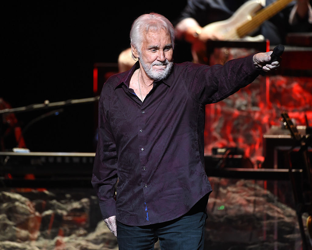 Kenny Rogers performs onstage during his final world tour | Kevin Winter/Getty Images