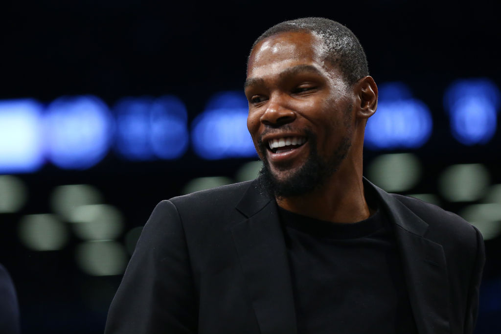 Kevin Durant smiling off camera on the basketball