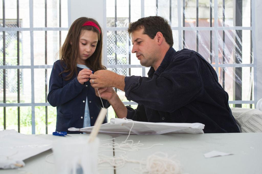 Girl making kite