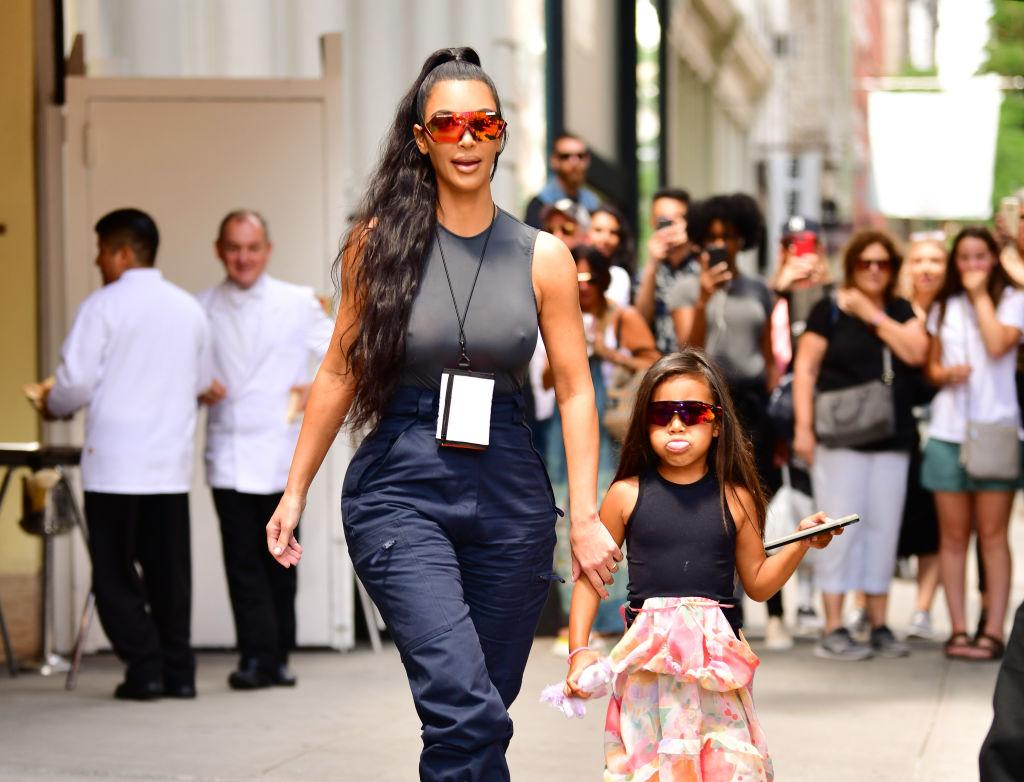 Kim Kardashian West and North West walking down the street