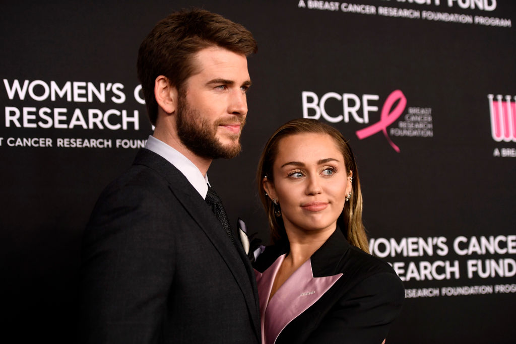 Liam Hemsworth and Miley Cyrus on the red carpet at an event in February 2019