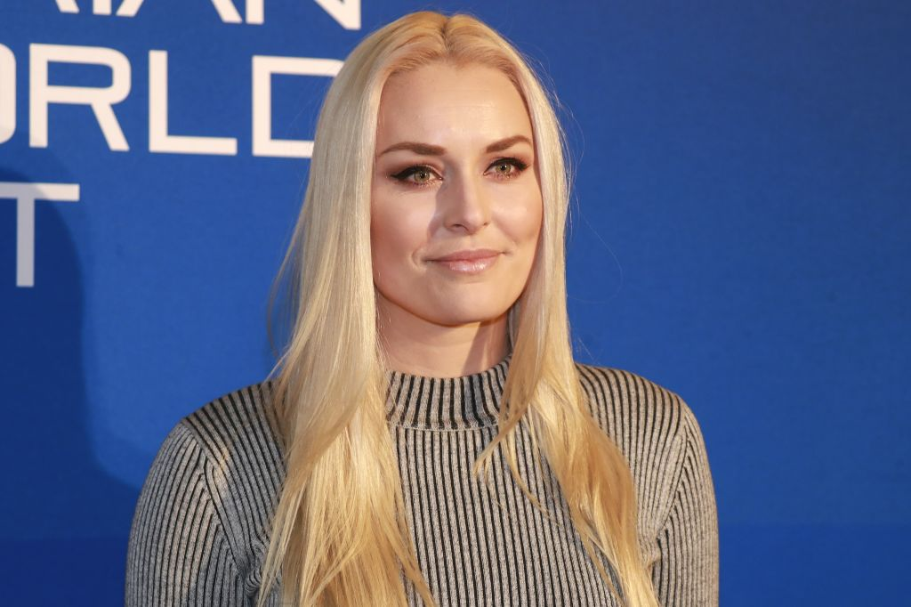 Lindsey Vonn smiling in front of a blue background
