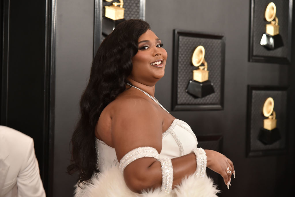 Lizzo smiling, turned to the side