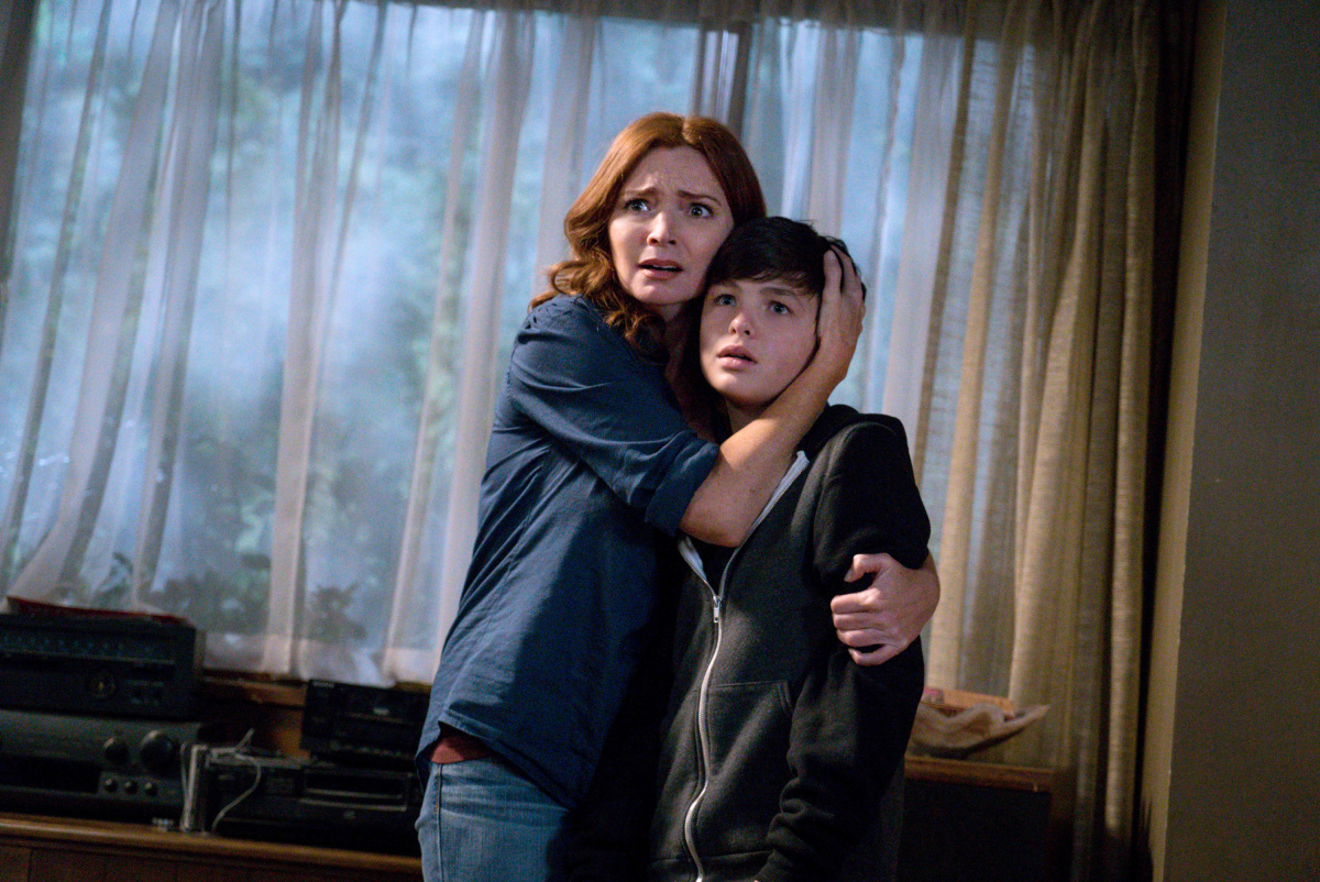 Brigid Brannagh with her arms around Logan Williams in 'Supernatural'