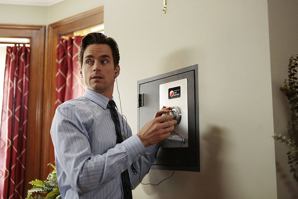 Matt Bomer as Neal Caffrey in 'White Collar' trying to unlock a safe