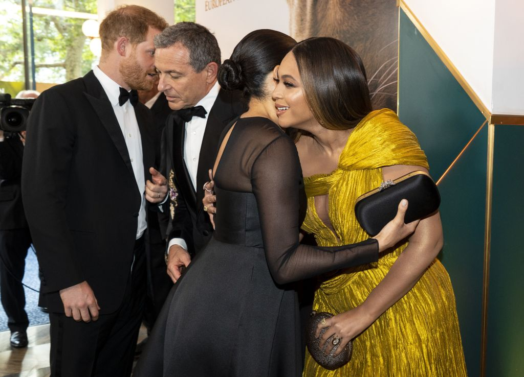 Britain's Prince Harry, Duke of Sussex with Disney CEO Robert Iger as Britain's Meghan, Duchess of Sussex embraces US singer-songwriter Beyoncé