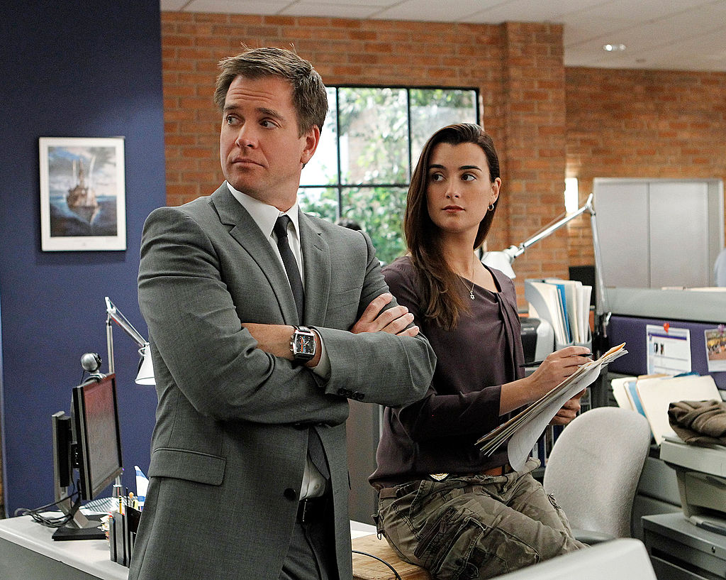 Michael Weatherly and Cote de Pablo on the set of NCIS. | Sonja Flemming/CBS via Getty Images