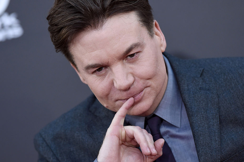 Mike Myers with his pinky to his lips