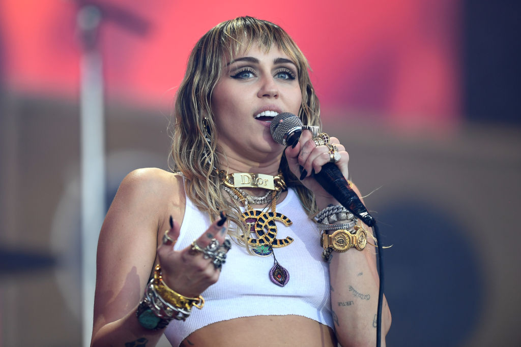 Miley Cyrus onstage at a festival in June 2019 in Glastonbury, England