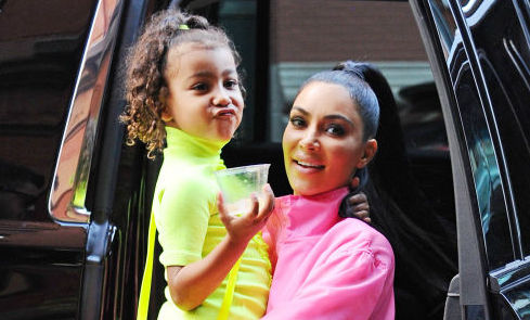 North West and Kim Kardashian West outside in September 2018