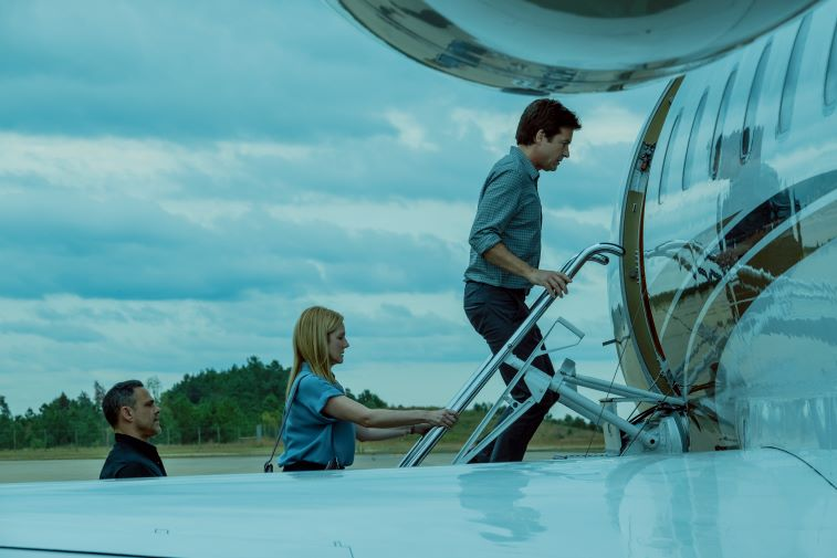 Jason Bateman and Laura Linney boarding a plane in 'Ozark' Season 3