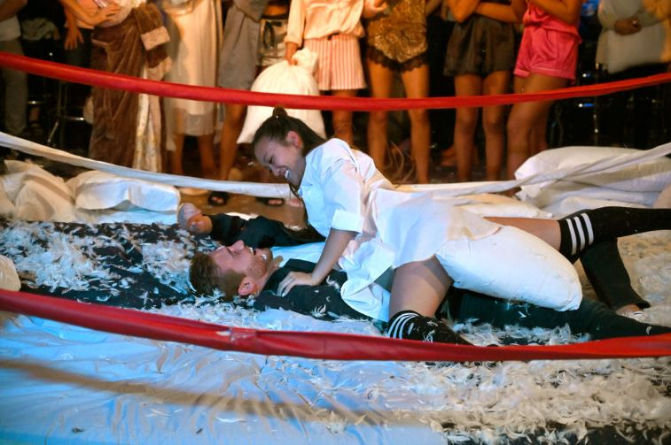 Tammy Ly on top of Peter Weber after the pillow fight group date