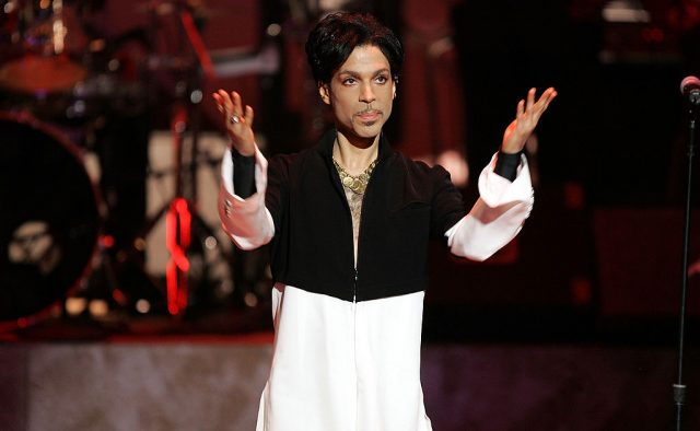 Prince stands onstage