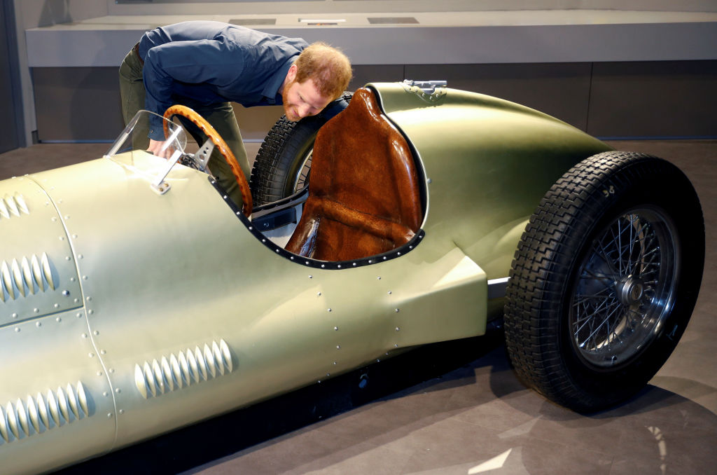 Prince Harry looking at a vintage car