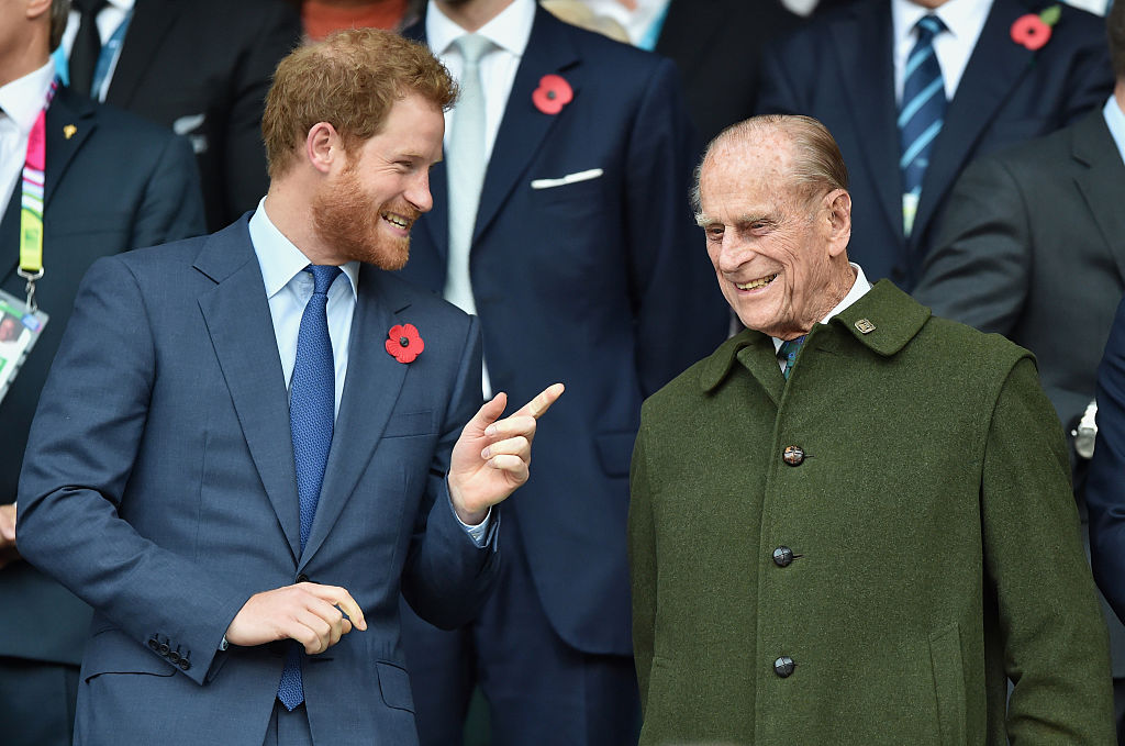 Prince Harry and Prince Philip, Duke of Edinburgh attend the 2015 Rugby World Cup Final match between New Zealand and Australia at Twickenham Stadium on October 31, 2015 in London, England