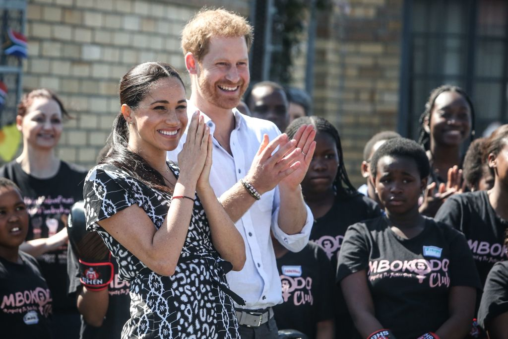 """Prince Harry and Meghan, Duchess of Sussex arrive for a visit to the """"Justice desk"""", an NGO in the township of Nyanga in Cape Town"""
