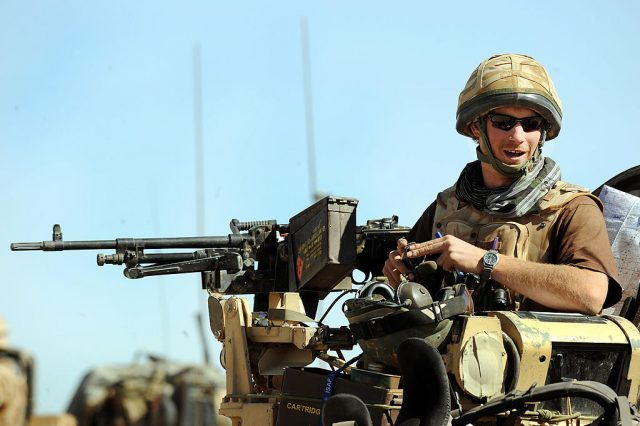 Prince Harry sits in an armored car