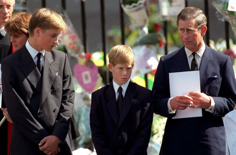 Prince William, Prince Harry, and Prince Charles stand together at Princess Diana's funeral in 1997