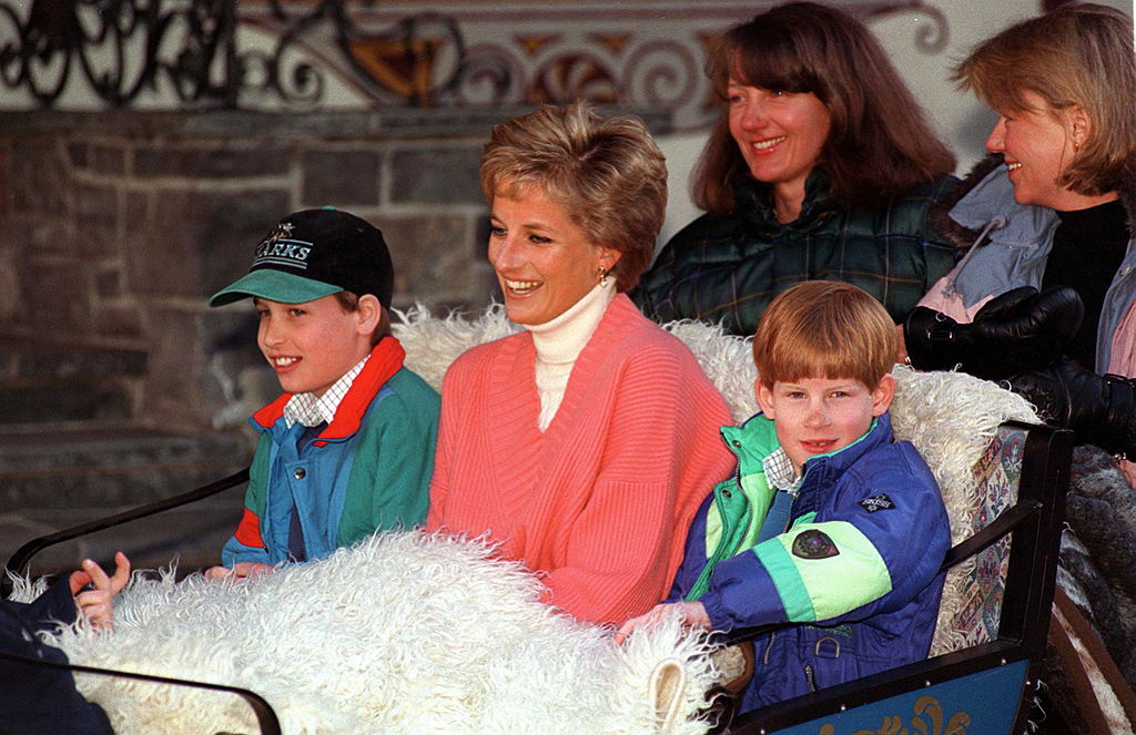 Prince William, Princess Diana, and Prince Harry in a sleigh