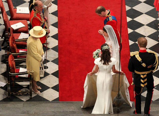 Prince William and Kate Middleton bow to Queen Elizabeth II at their royal wedding, 2011