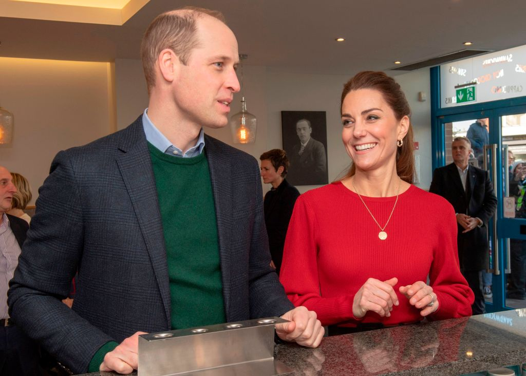 Prince William and Catherine, Duchess of Cambridge chat at the counter, during their visit to Joe's Ice Cream Parlour in Mumbles