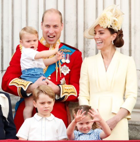 Prince William holding Prince Louis, Kate Middleton, Prince George, and Princess Charlotte