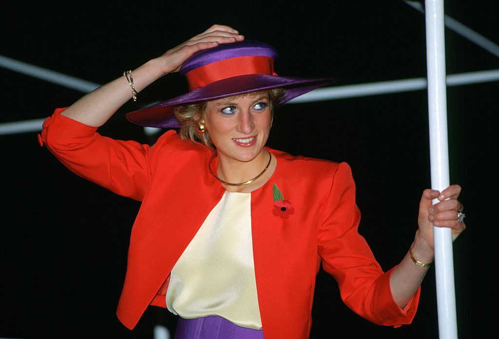 Princess Diana in a bold red and purple outfit