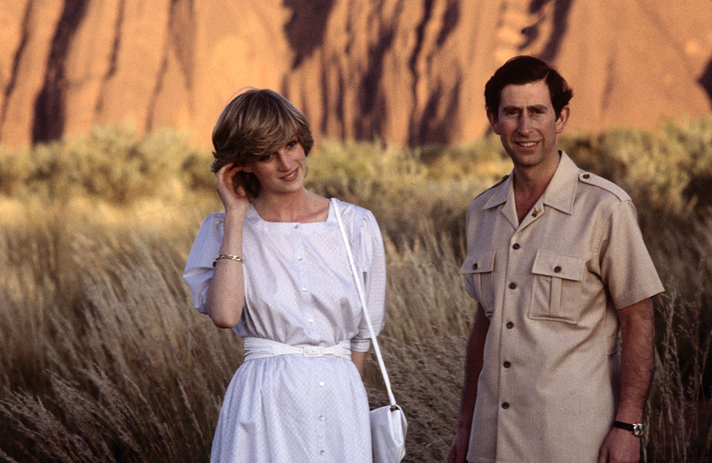 Diana Princess of Wales and Prince Charles pose in front of Ayer's Rock on March 21, 1983 near Alice Springs, Australia during the Royal Tour of Australia. Diana wore a dress designed by Benny Ong