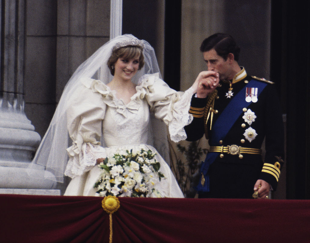 The Prince and Princess of Wales on the balcony of Buckingham Palace on their wedding day, 29th July 1981. She wears a wedding dress by David and Elizabeth Emmanuel and the Spencer family tiara