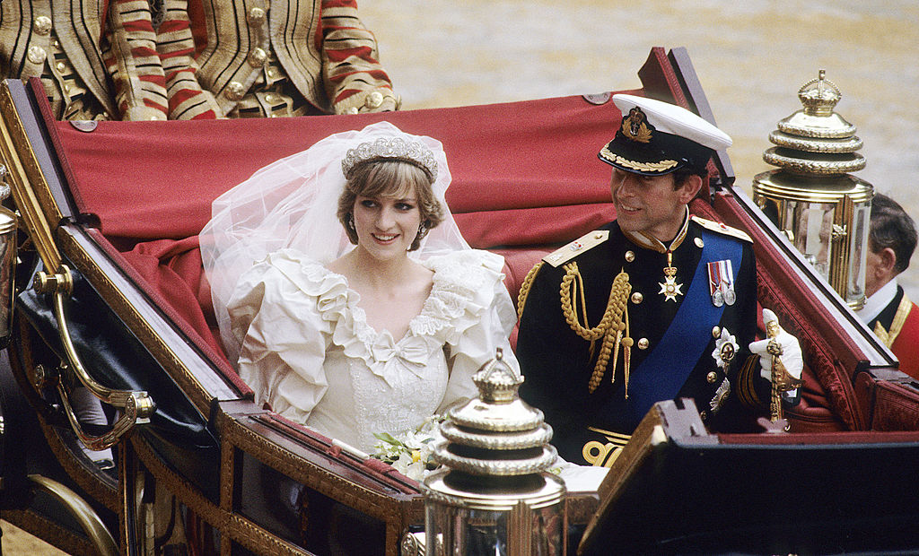 Diana, Princess of Wales and Prince Charles ride in a carriage after their wedding at St. Paul's Cathedral July 29, 1981 in London, England